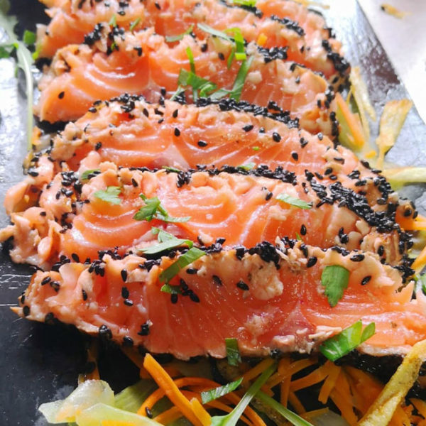 Tataki of salmon marinated with citrus and sesame